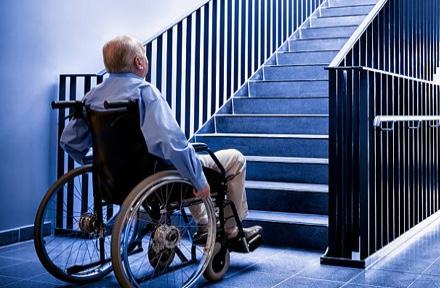 How to Get a Wheelchair Up a Flight of Stairs
