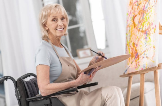 Painting in a wheelchair