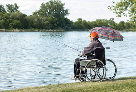 Wheelchair bound senior fishing
